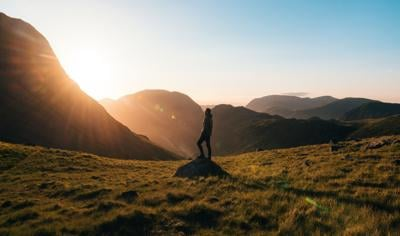 Man standing on a rock at sunrise
