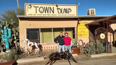 erik hoyer and madelyn hines in front of the town dump in cave creek
