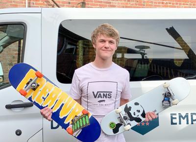 Jace Sams with skateboards photo