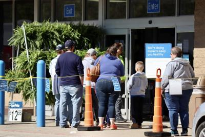 Photo: Walmart limits number of customers inside stores