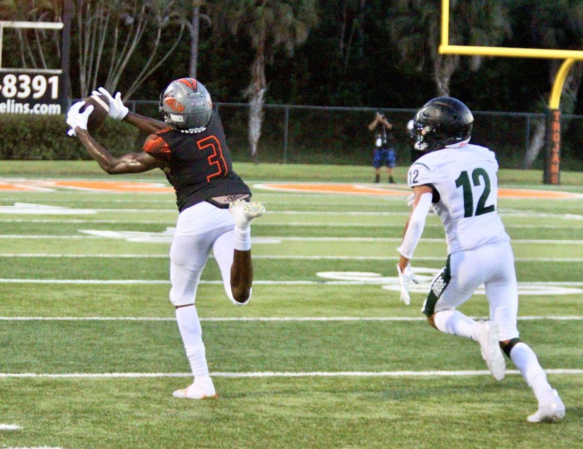 Big Play Defense 1. Omar Vilsaint catches a perfect pass in Lely's 14-3 win over Palmetto Ridge..jpeg