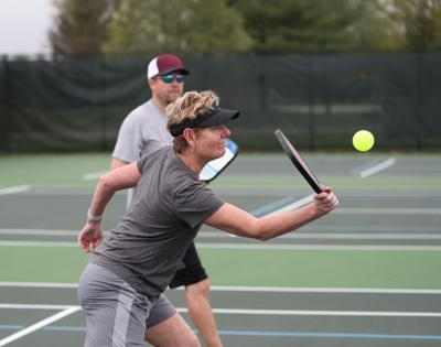 Coach Wayne's Corner,Pickleball,Forehand,Is,Hit,During,A,Mixed,Doubles,Match.