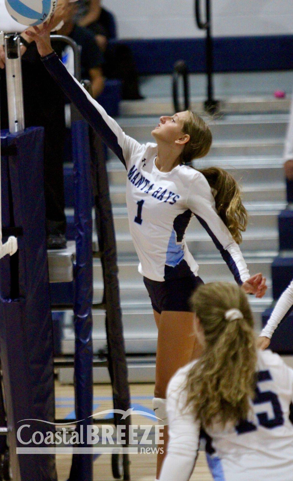 MIA_3. Sophomore Jenna Ragan makes a play at the net..JPG