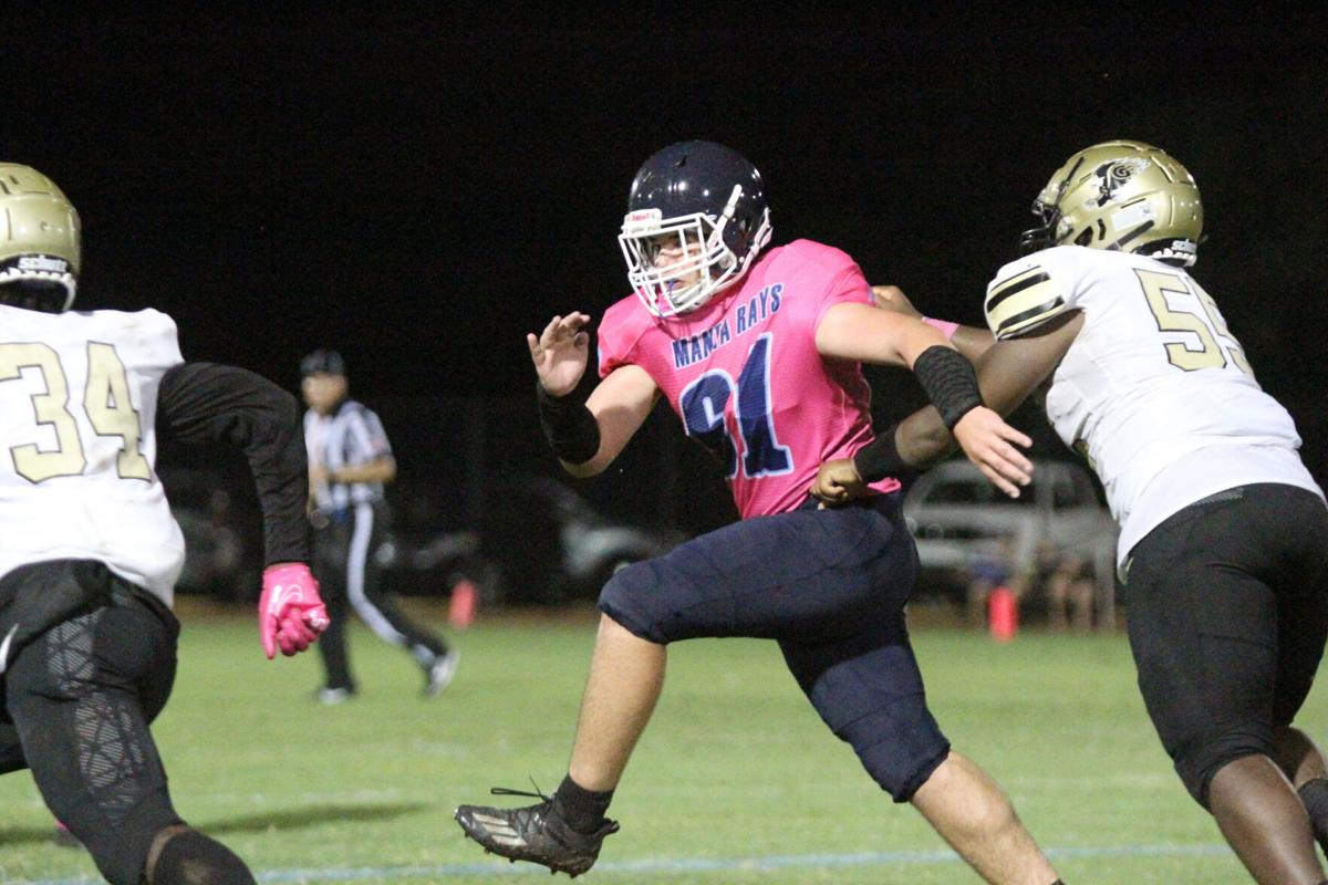 MIA Falls 2. Middle linebacker Hunter Pisano pursues the Gateway ball carrier.  Pisano picked off a Gateway pass earlier in the game..jpeg