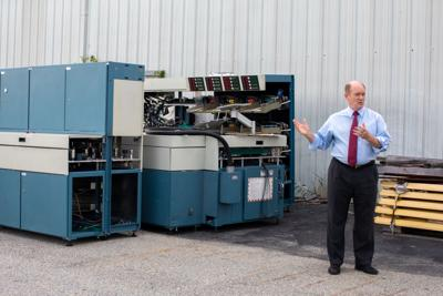 U.S. Sen. Chris Coons with removed USPS sorting equipment