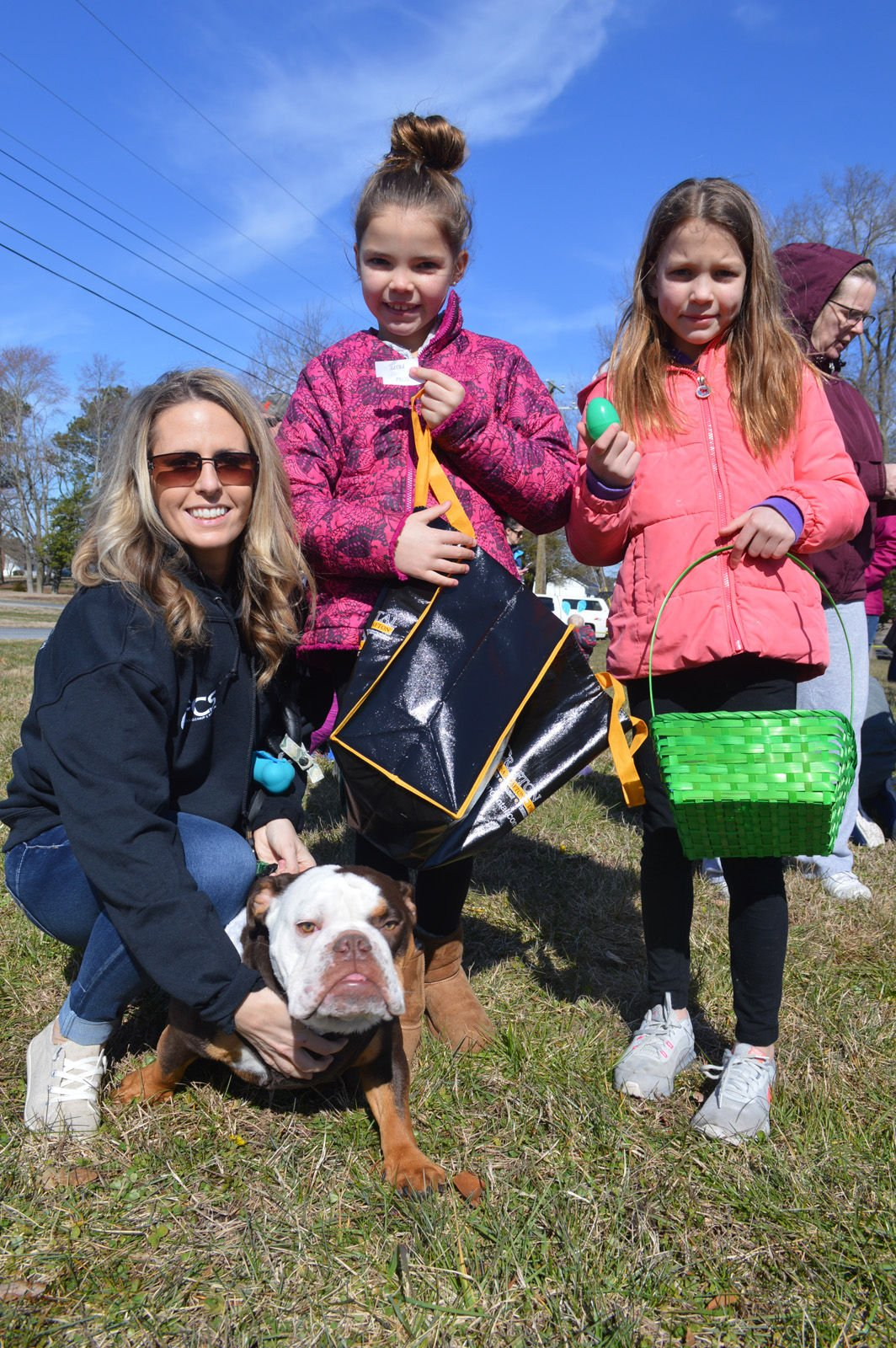 Dagsboro egg hunt - From left, Katy, Emmalee and Erika Ernest, with their English bulldog, Romeo-LW.jpg