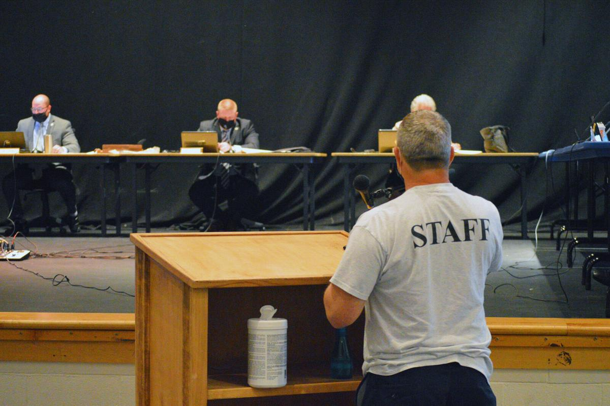 IRSD board Aug 2020- disinfects public podium-LW.jpg (copy)