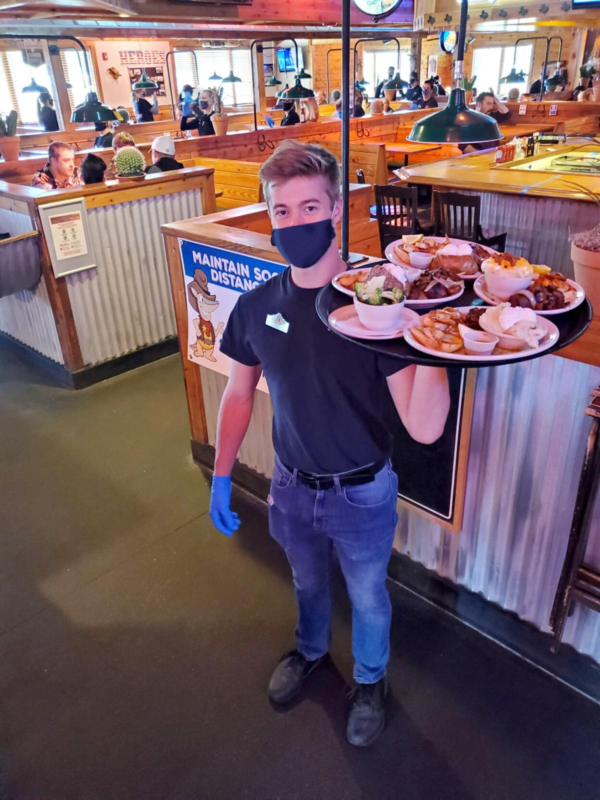 Server holds tray of food - mask.jpg