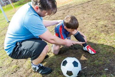 Father and son on the soccer field