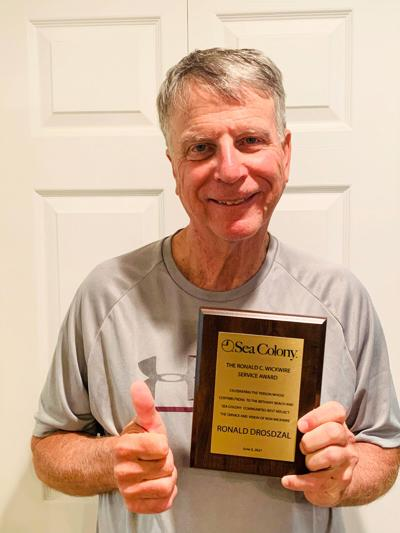 Drosdzal presented with award for contributions to community