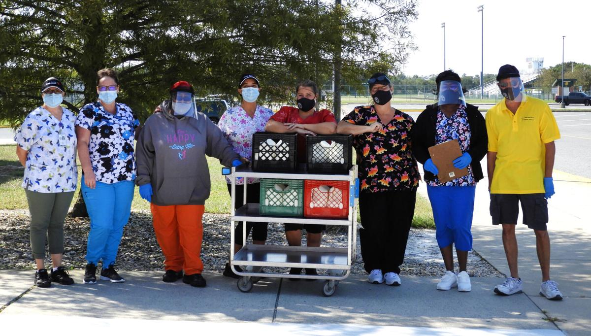 IRHS nutrition services staff with meals