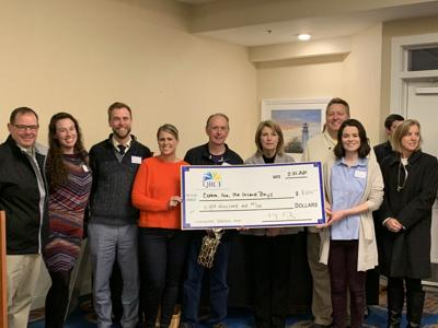 Chamber, QRCF present donations at networking event