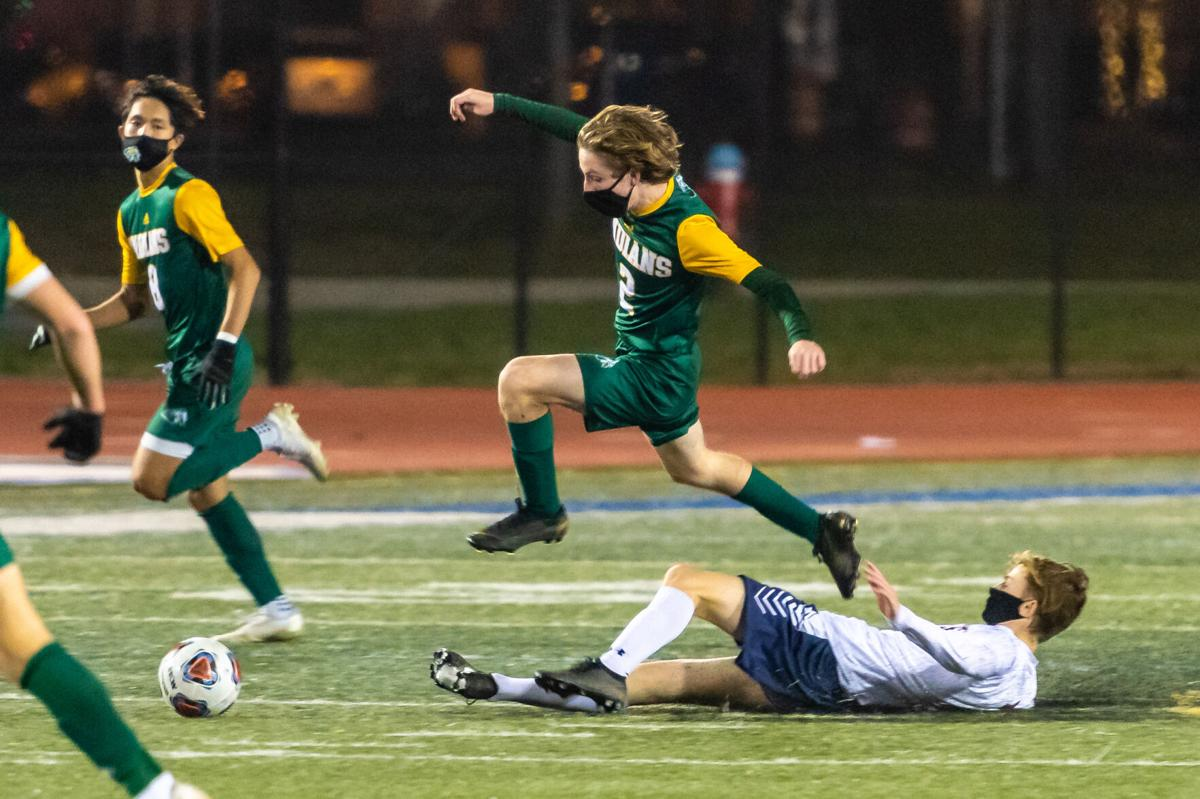 IR Boys' Soccer vs. Newark Charter School - State Championship - Blake Morgan jumps over a defender-SLam-2082.jpg (copy)