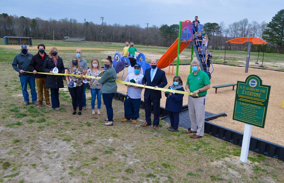 JMC playground ribbon cutting