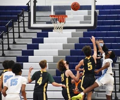 IRHS boys basketball - fight for the rebound
