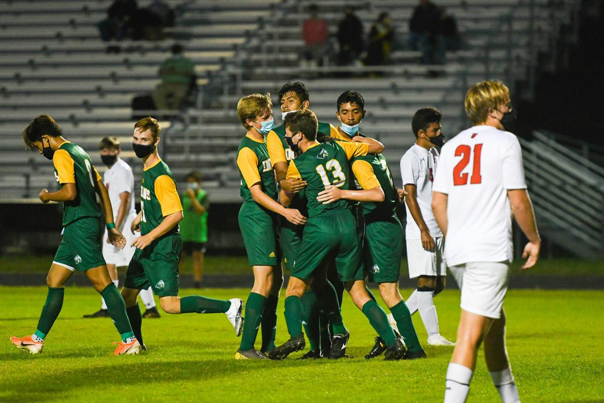 Indian River High School Boys' Soccer vs. PolyTech - Blake Morgan celebrates with his teammates after the first goal-SLam-0610.jpg