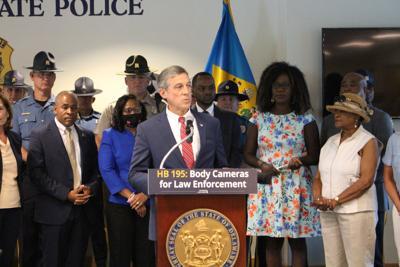 Carney speaks at body camera bill signing