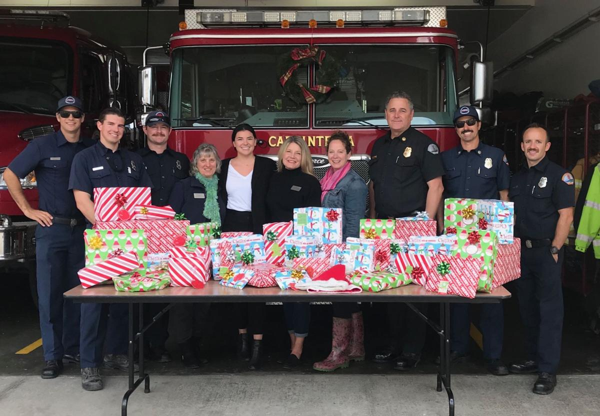 Firefighters bring holiday cheer to families in need