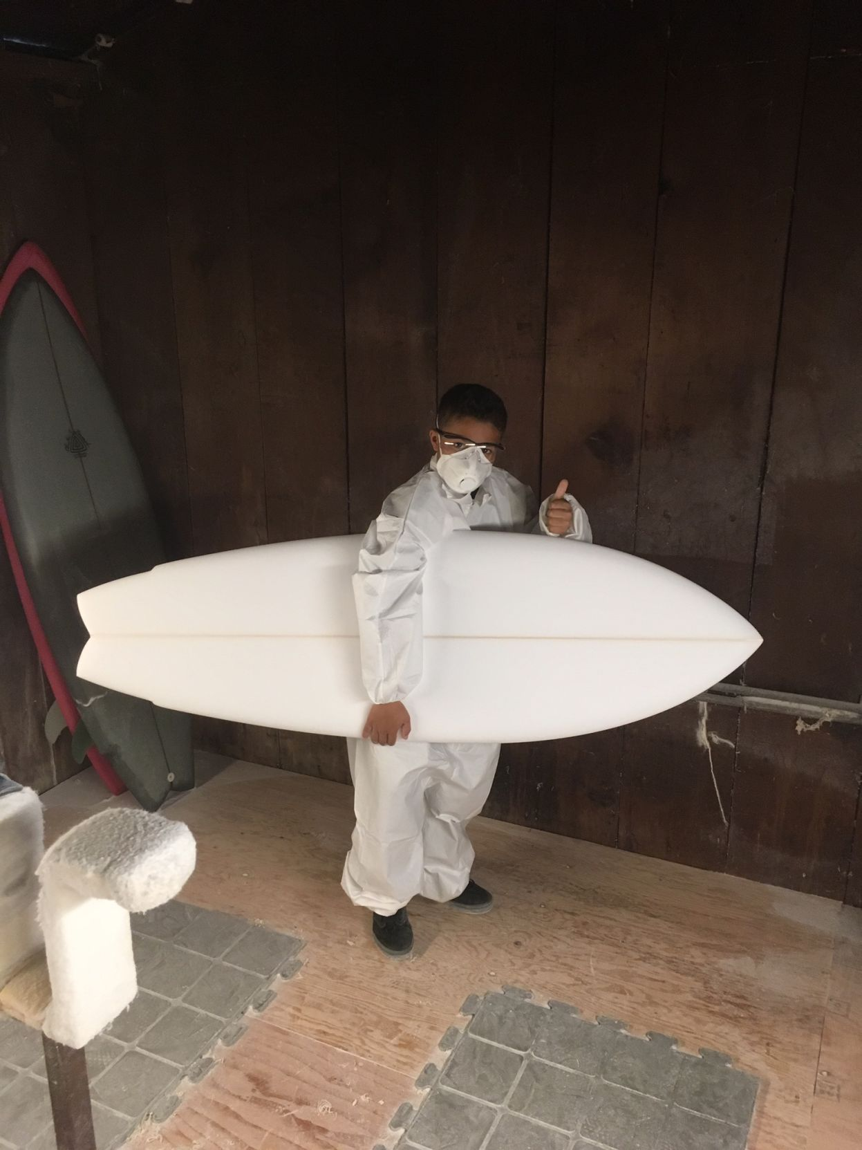 Surfboard-shaping student