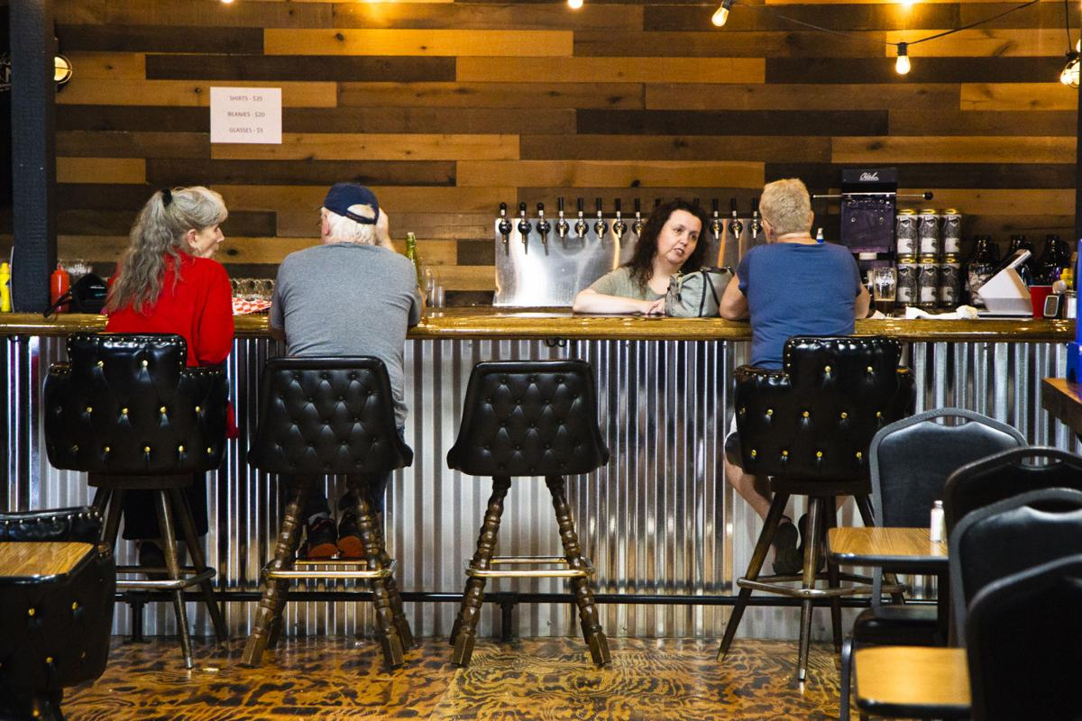 The bar top was built from reclaimed lumber salvaged from a local homestead barn more than 100-years-old