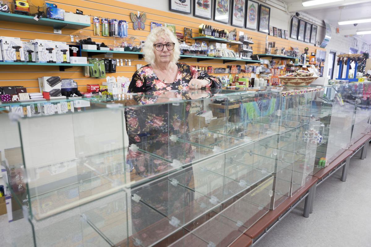 Herb-N-Legend owner Lynda Kinnunen stands behind empty display cases