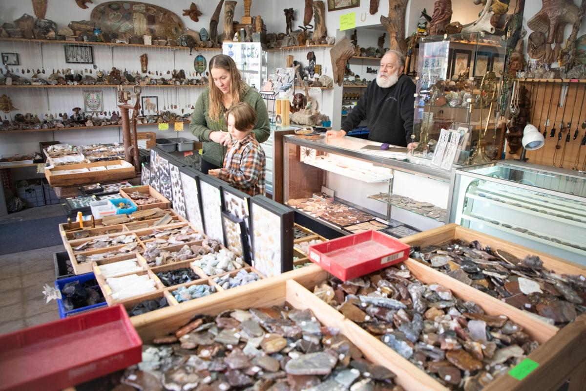 Customers browse the section of metaphysical stones