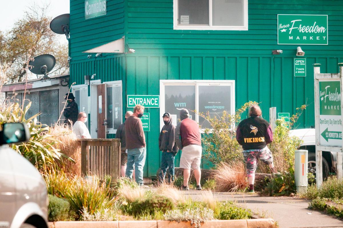 Customers line up to buy marijuana