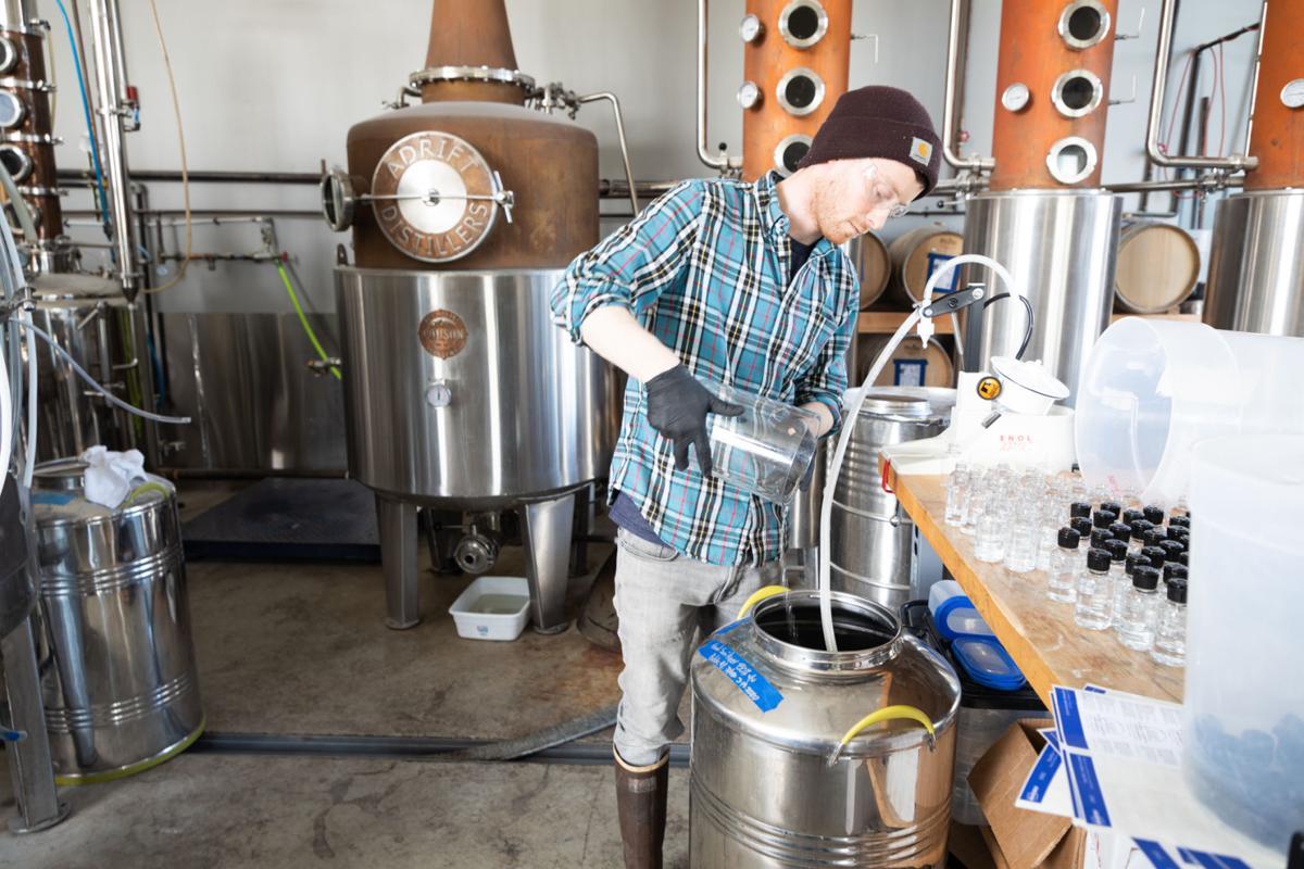 Jacob Moore of Adrift Distillers prepares hand sanitizer