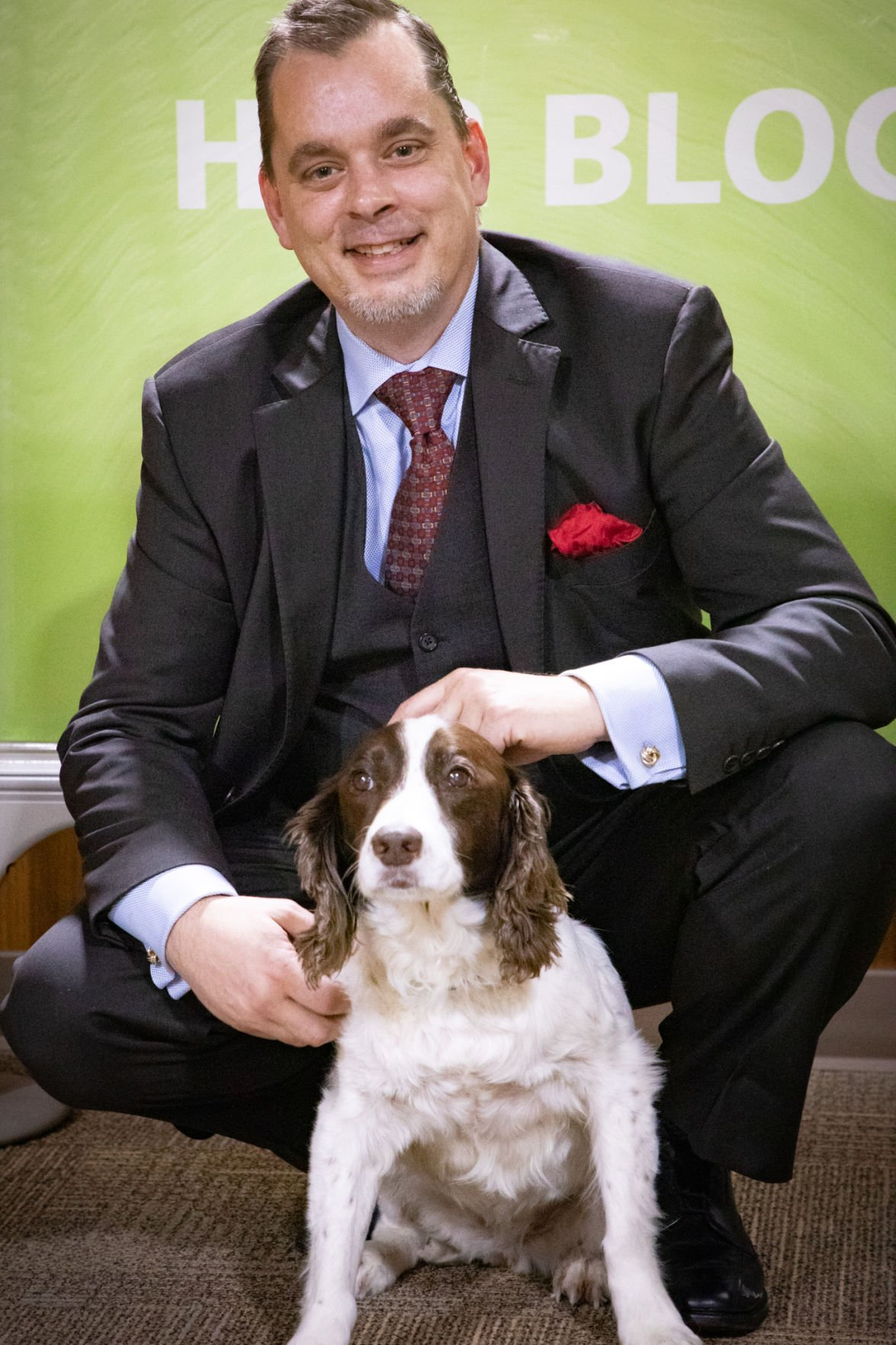 H&R Block Tax Consultant Chris Holloway poses with Millie