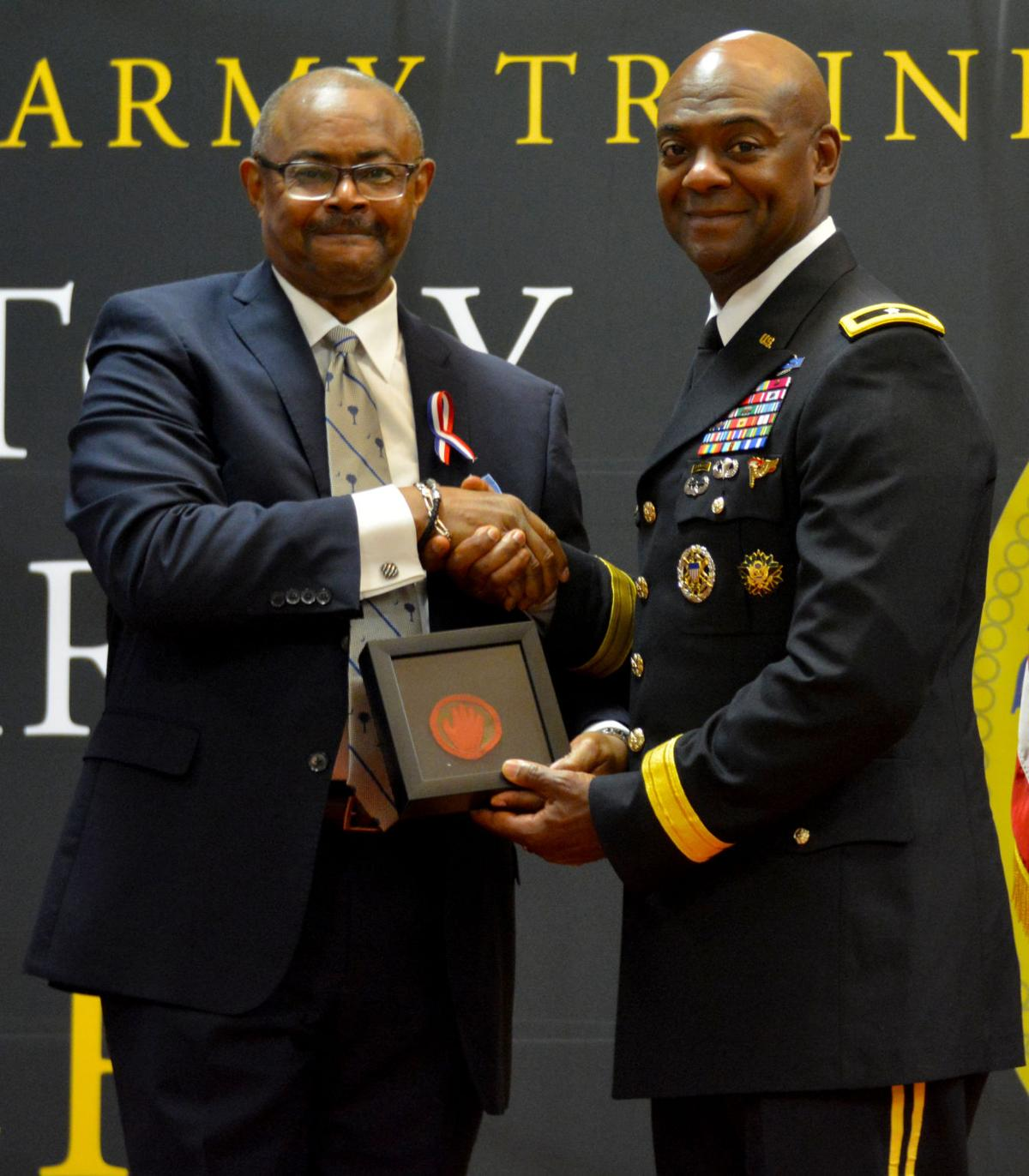 Brig. Gen. Milford H. Beagle, Jr., Fort Jackson commanding general, receives a token of appreciation from Mr. Perry Lloyd following Purple Heart ceremony
