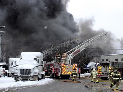 Firefighters battle blaze at truck center