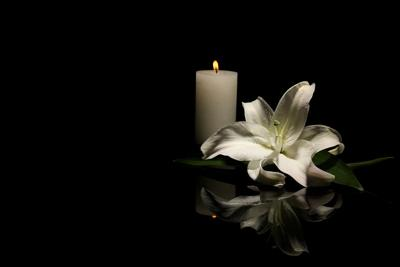 Funeral flowers with candle