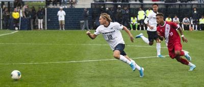 Men's Soccer v. Indiana, Stevenson (18) Runs To Ball