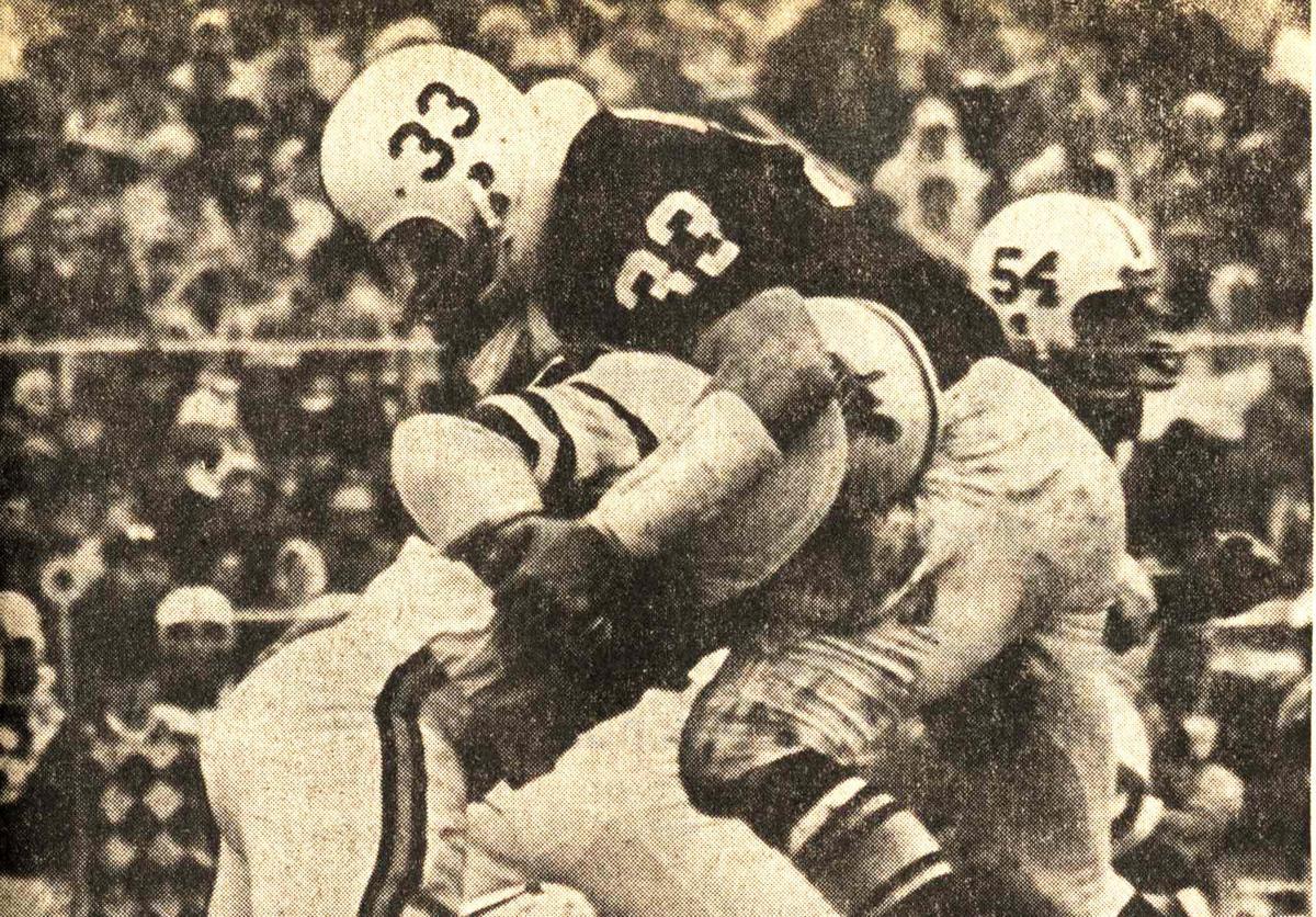 Jack Ham makes a tackle