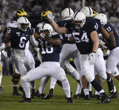 Football vs. Michigan, Brown (6), Toney (18) and Windsor (54)