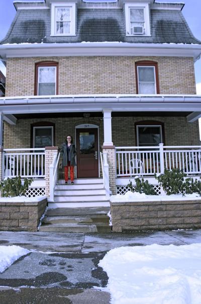Jennifer stands by house