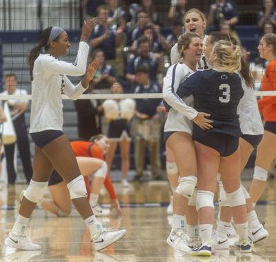 NCAA Women's Volleyball Regional second round, Jenna Hampton (15) and Kendall White (3) celebrate