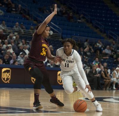 Women's basketball vs Minnesota, Teniya Page (11) dribbles