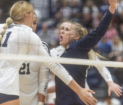 NCAA Women's Volleyball Regional second round, Kendall White (3) and Tori Gorrell (11) celebrate