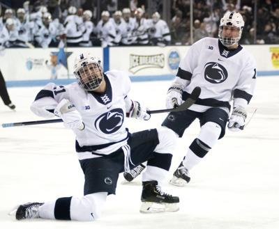 Men's hockey vs. Minnesota, Wall (21) and Snell (16)
