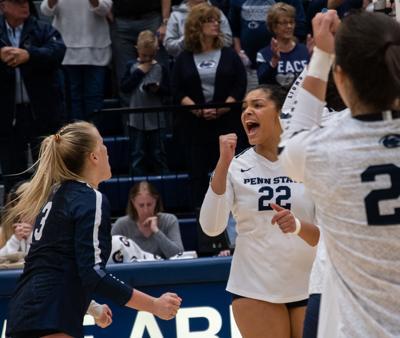 Women's volleyball vs Maryland, Allyson Cathey (22) celebrates