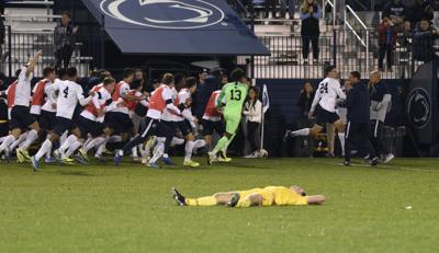 Men's soccer vs. Maryland, Sload (24) and Penn State players