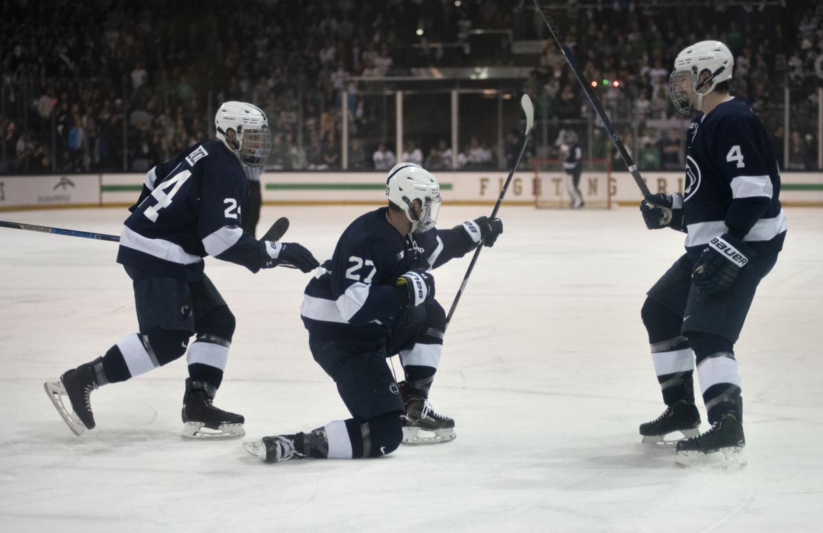 Big Ten Men's Ice Hockey Tournament Championship Game vs. Notre Dame, Sternschein (27), Pilewicz (24) and Myllari (4)