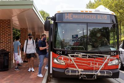Students Getting on CATA Bus
