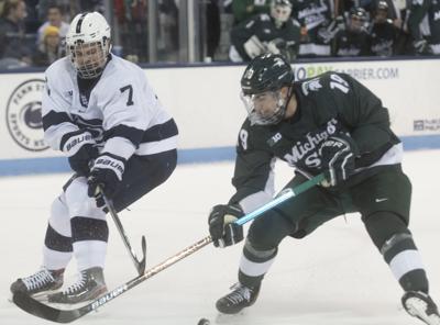 Men's Hockey vs. Michigan State, Bell (7)