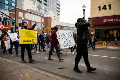 Protestors march down Beaver Avenue