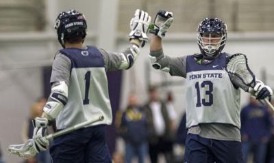 Men's Lacrosse, Navy, Grant Ament (1) high fives Nick Spillane (13)