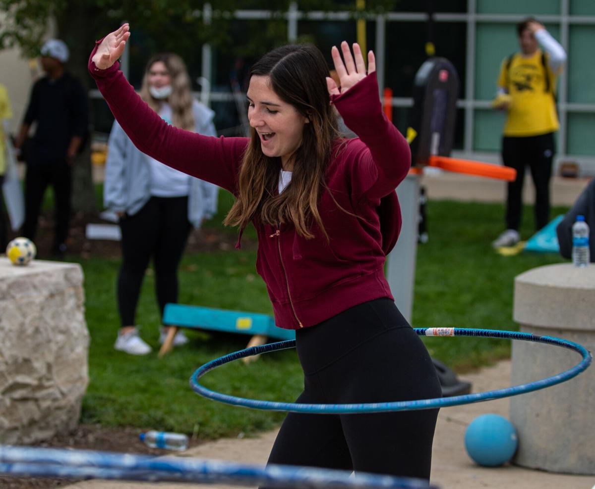 Hailey Tyrell hula hoops at THON 5K