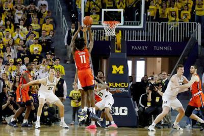 Big Ten men's basketball roundup | Dosunmu comes through in the clutch and Indiana falls short