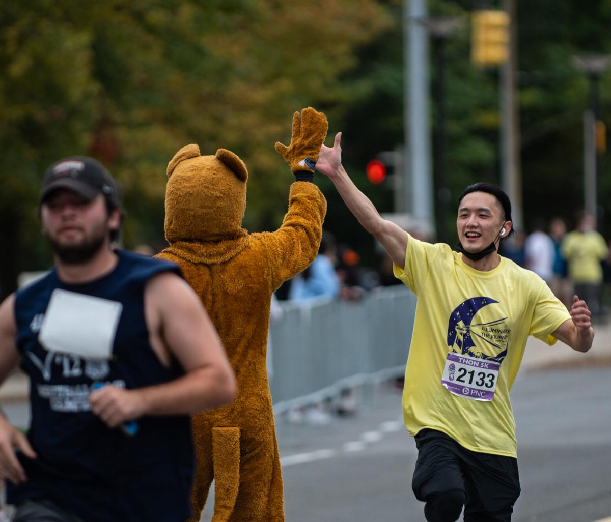 THON 5K, Tzu Hsiang Yeh high fives Nittany Lion